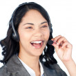 Stock Photo: Smiling businesswomwith headset on