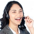 Businesswoman with a headset on talking - Zdjęcie stockowe