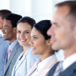 Attractive businesswoman with her team in a row — Stock Photo