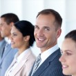 Attractive businessman in a row with his team — Stock Photo #10279964
