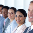 Stock Photo: Beautiful businesswoman with her team in a line