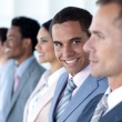 Handsome leadership in a row with his team — Stock Photo