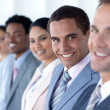 Attractive businessman in a row with his team — Stock Photo