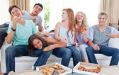 Teenagers eating pizza at home — Stock Photo