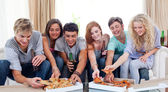 Teenagers eating pizza at home — Stok fotoğraf