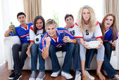 Teenagers watching a football match at home — Stock Photo