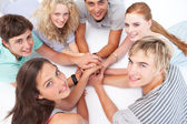 Teens playing on the floor hands games — Stock Photo