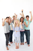 Successful friends standing against white background — Stock Photo