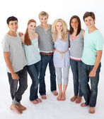 Group of friends standing against white background — Stock Photo