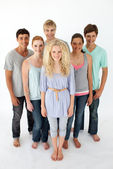 Group of teenagers standing in front of the camera — Stock Photo
