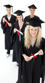 Smiling group of teenagers celebrating after Graduation — Stock Photo