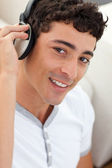 Portrait of teen guy listening to music — Stock Photo