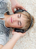 Portrait of teen guy listening to music — Стоковое фото