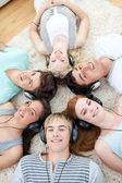 High angle of teenagers listening to music — Stock Photo