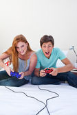 A excited teen couple playing video games — Stock Photo