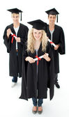 Group of adolescents celebrating after Graduation — Stock Photo