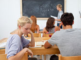 Tired teenager getting bored in a class — Stock Photo