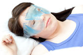Brunette woman with an eye gel mask — Stock Photo