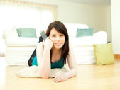 Passionate woman watching television — Stock Photo