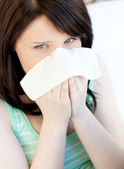 Portrait of a sick caucasian teen girl blowing — Stock Photo