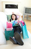 Tired woman relaxing after shopping — Stock Photo