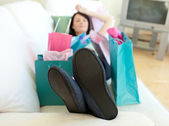 Brunette woman relaxing after shopping — Stock Photo