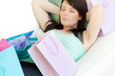 Exhausted young woman relaxing after shopping — Stock Photo