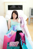Cheerful woman relaxing after shopping — Stock Photo