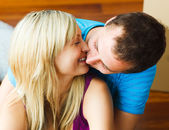 Close-up of couple moving to new house and kissing — Stock Photo