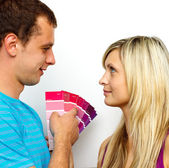Couple chosing colours for painting house. Concept of decoration — Stock Photo
