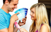 Couple with colour samples to paint new apartment. Concept of de — Stock Photo