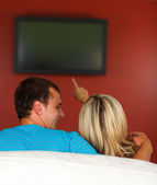 Lovers watching a television at home — Stock Photo