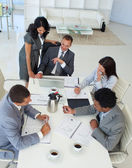 Businessteam talking about a project in a meeting — Stock Photo