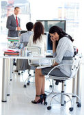 Tired businesswoman in a meeting — Stock Photo