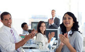 Businessteam applauding a colleague after a presentation — Stock Photo
