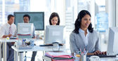 Businesswoman in a call center with her colleagues — Stock Photo