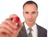 Businessman using a red felt-tip pen — Stock Photo
