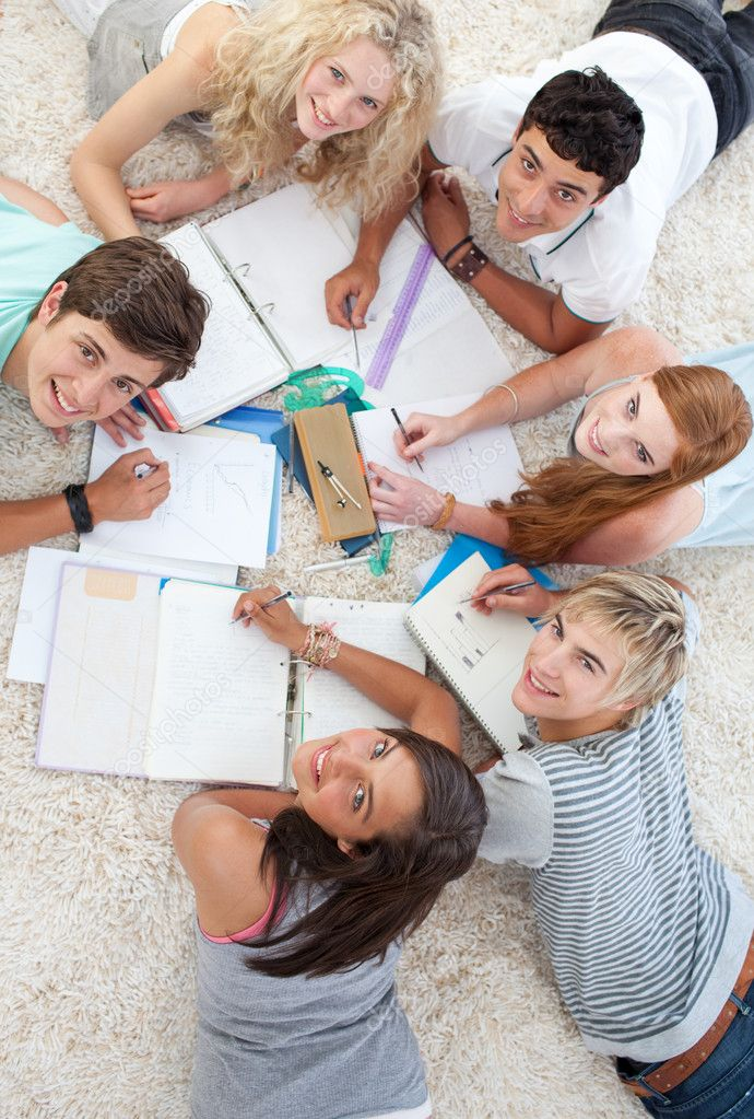 Group of Teenagers lying on the ground studying together — Stock Photo #10278323