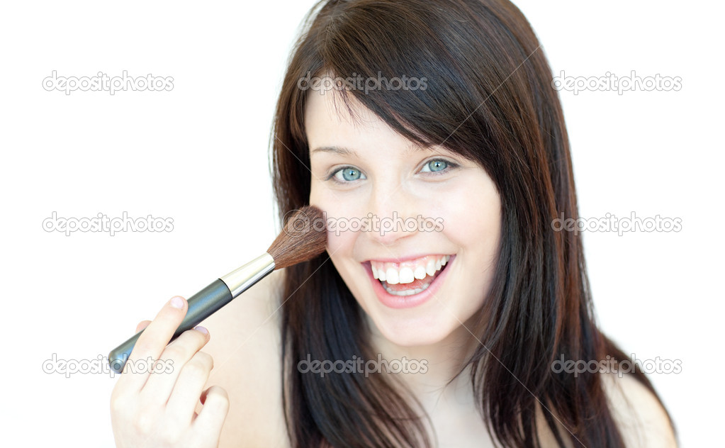 Happy woman using a powder brush against a white background — Stock Photo #10278826
