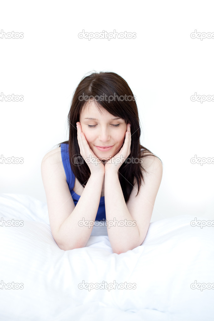 Portrait of a tired woman sitting on her bed at home — Stock Photo #10278846