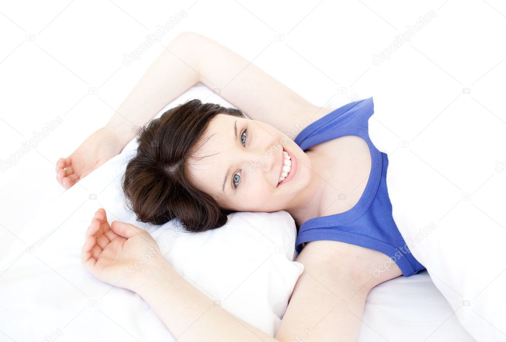 Close-up of a smiling woman waking up slowly against a white background — Stock Photo #10278865