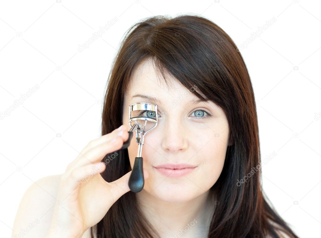Cute teen girl using an eyelash curler against a white background — Stock Photo #10278928