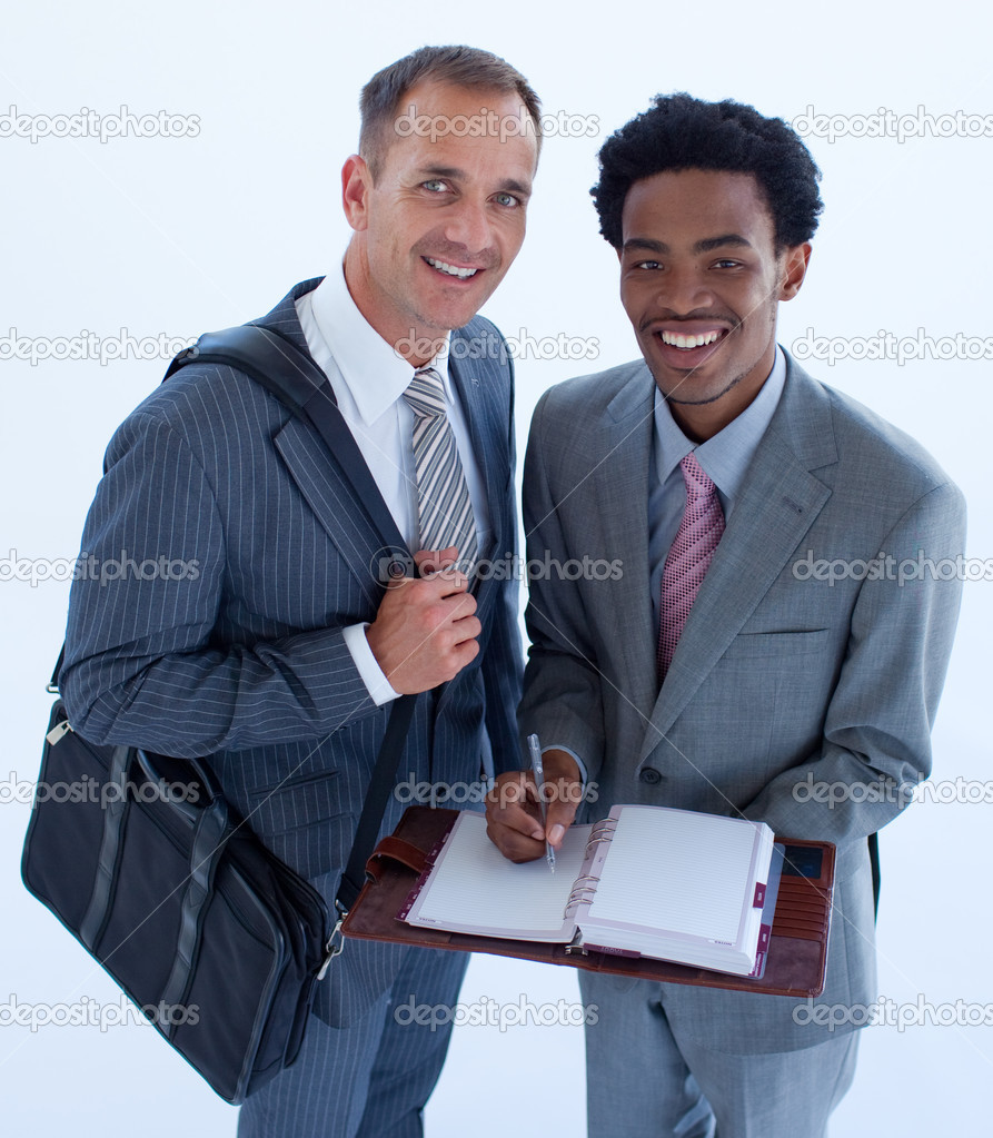 High angle of smiling businessmen writing in a business diary — Stock Photo #10279636