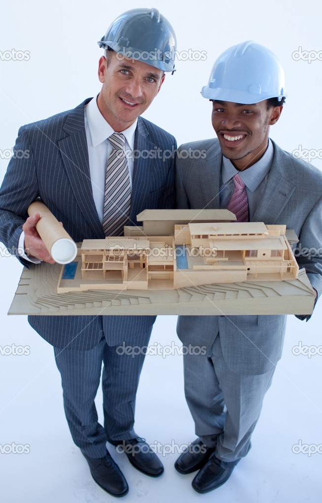 High angle of engineers with hard hats holding a model house — Stock Photo #10279647