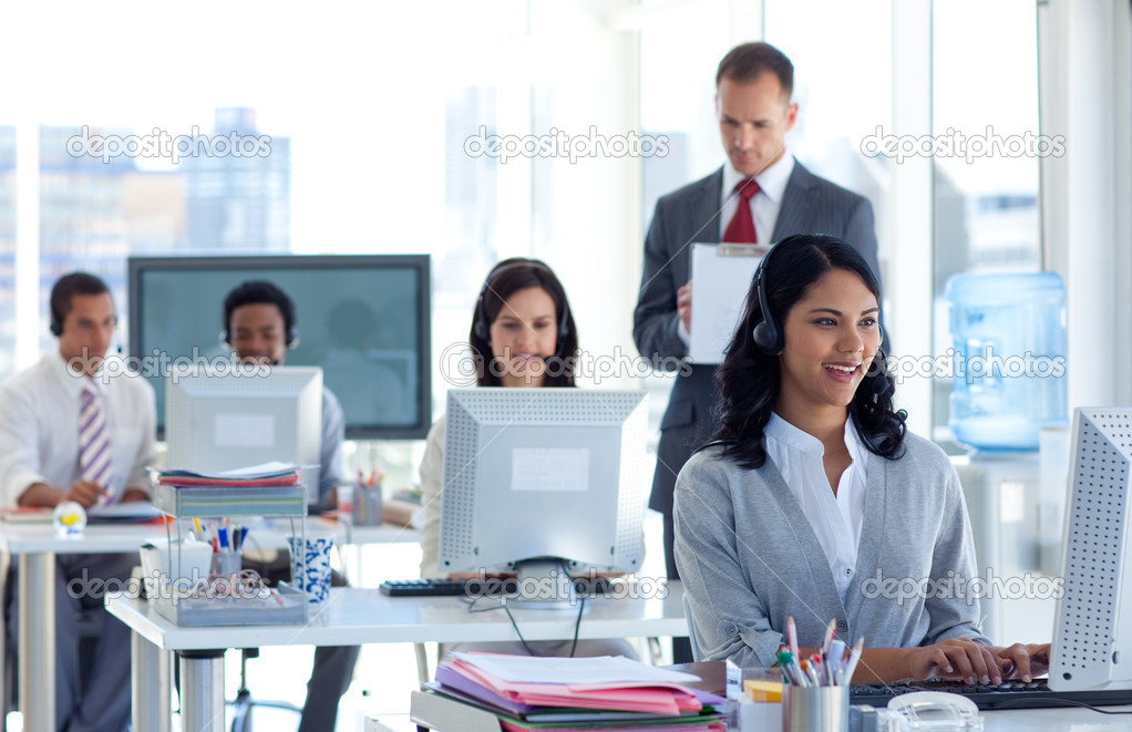 Attractive male supervisor taking notes in a call center — Stock Photo #10279812