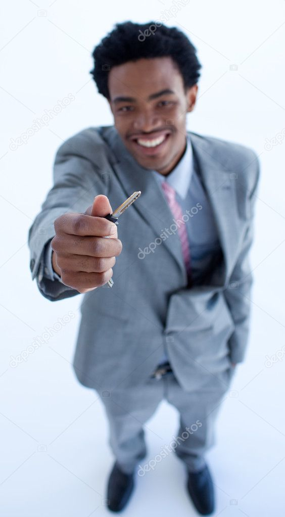 High angle of Afro-American businessman holding a key. Property concept — Stock Photo #10279839