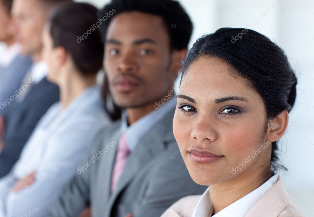 Confident businesswoman with her team in a line looking at the camera — Stock Photo #10279935