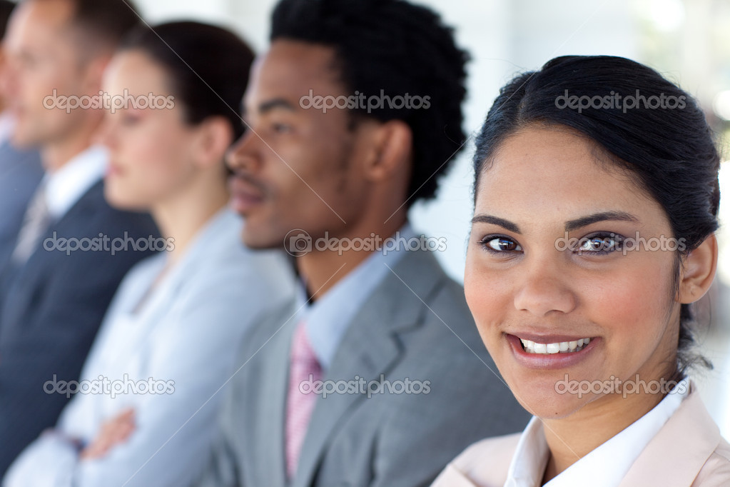 Beautiful businesswoman with her team in a line smiling at the camera — Stock Photo #10279937