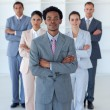 Stock Photo: Afro-American businessman in front of his team