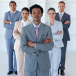 Afro-American businessman in front of his team — Stock Photo